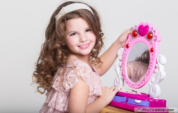 Cute-little-girl-with-toy-mirror-and-lipstick.-Child-cosmetics