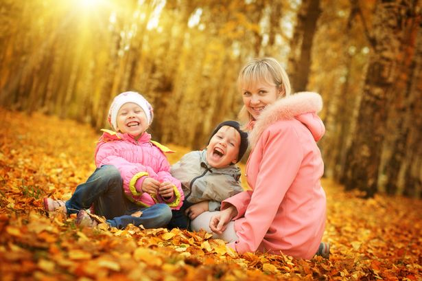Mother and children in autumn park